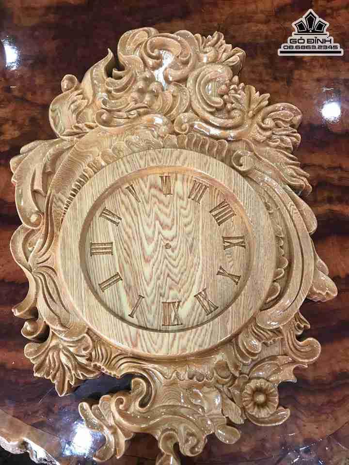 Đồng hồ gỗ treo tường chạm khắc